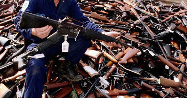 (FILES) This file photo taken on September 8, 1996 shows Norm Legg, a project supervisor with a local security firm, holding up an armalite rifle which is similar to the one used in the Port Arthur massacre and which was handed in for scrap in Melbourne after Australia banned all automatic and semi-automatic rifles in the aftermath of the Port Arthur shooting. When Martin Bryant massacred 35 people with semi-automatic weapons at Port Arthur in 1996, then-Australian prime minister John Howard reacted swiftly by pushing for tough new national gun laws. Within a year gun licences had been tightened, a weapons buy-back was enacted and an amnesty launched for anyone holding illegal arms, moves that took more than 600,000 guns out of action. AFP PHOTO / FILES / William WEST (Photo credit should read WILLIAM WEST/AFP/Getty Images)